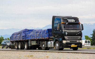 O'Higgins, Chile - November 19, 2015: Black semi-trailer truck CNHTC Sinotruck at the interurban freeway.